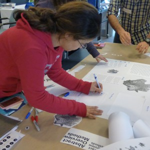Graduate students applied new design skills to develop a scientific poster as part of a Metcalf Science Communication Workshop. Photo by Karen Southern.